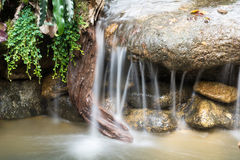 Waterfall and green stream in the forest Thailand Stock Photos