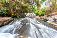Waterfall and green stream in the forest Thailand Royalty Free Stock Photography