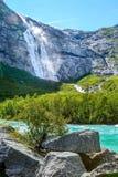 Way to Briksdal glacier, waterfall in Norway. Waterfall and green trees on the way to Briksdal or Briksdalsbreen glacier in Olden, Norway stock image