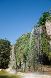 Waterfall and grotto in the Genoves park, Cadiz Stock Photography