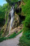 Waterfall with guiding path Stock Images