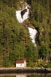 Waterfall on Hardangerfjord, Norway Stock Image