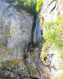 Waterfall Vanturatoarea from the Cerna Valley. Stock Photo