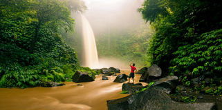 Waterfall hidden in the tropical jungle Stock Photography