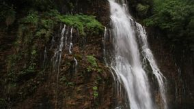 Waterfall on hillside stock video