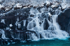 The Waterfall Hraunfossar. In Iceland, February Stock Photo