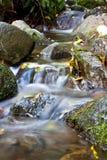 Waterfall. A huge beautiful waterfall surrounded by rocks Stock Photo