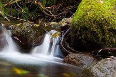 Waterfall. A huge beautiful waterfall surrounded by rocks Royalty Free Stock Photos