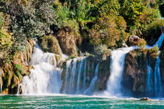 Waterfall. A huge cascade surrounded by rocks Royalty Free Stock Photos