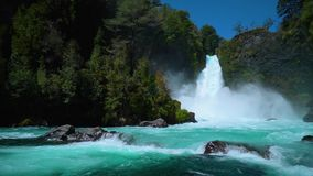Waterfall in Huilo Huilo. Huge waterfall in Chilean scenery Huilo Huilo stock footage