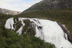 Waterfall in Husedalen valley in Hardangervidda national park, Norway Royalty Free Stock Photography