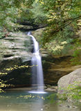 Waterfall I. Color photo of a water fall, with fall foliage royalty free stock photo
