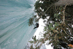 Waterfall Ice Climber. An ice climber picks his way up delicate frozen waterfalls Royalty Free Stock Photography