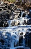 Waterfall ice in North Italy Mountain with rocks stock images
