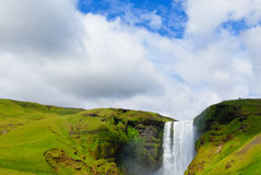 Waterfall in Iceland. Waterfall in a green landscape in Iceland Stock Photography