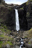 Waterfall Iceland. Picturesque Waterfall with green mossy rocks in Iceland Stock Photography