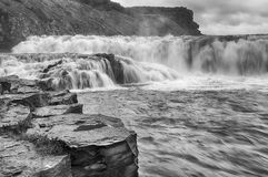 Waterfall in Iceland, black and white image. Stock Images
