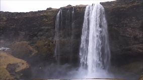 Waterfall in Iceland. One of many Iceland waterfalls with rainbow - seljalandfoss stock video
