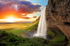 Waterfall, Iceland - Seljalandsfoss. Seljalandsfoss is one of the most beautiful waterfalls on the Iceland. It is located on the South of the island. With a Stock Photo
