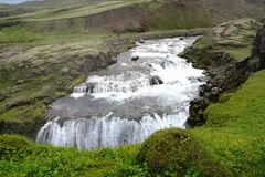 This waterfall in the Icelandic South highlands is call The Little Gullfoss or The Little Golden Waterfall. It is at Holaskjol