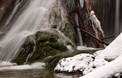 Waterfall with icicles on the mountain winter river Royalty Free Stock Photo