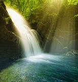 Waterfall illuminated by sunshine Royalty Free Stock Photo