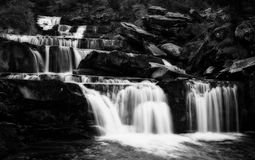 Waterfall image in black and white and with long exposure high contrast royalty free stock image