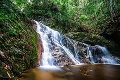 Waterfall inside tropical rainforest Stock Photos