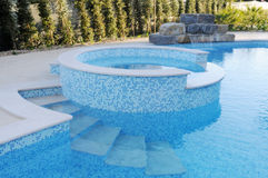 Pool with Blue Tiles, Artificial Waterfall, Round Kids Pool Stock Images