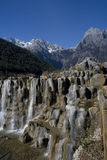 Waterfall at Jade Dragon Snow Mountain. Waterfall at Baishui (White River) Jade Dragon Snow Mountain, Lijiang, Yunnan, China stock image