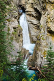 Waterfall at Johnston Canyon. Waterfalls flowing into bright turquoise pools in the mountains Royalty Free Stock Images
