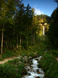 Waterfall in Julian Alps, Slovenia. Beautiful view from forest in Julian Alps with waterfall, Slovenia Royalty Free Stock Photography