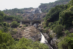 Waterfall in the jungle, a beautiful view of the railway on cliff .Indiya Goa Royalty Free Stock Image