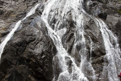 Waterfall in the jungle, a beautiful view of the steep rock .Indiya Goa Royalty Free Stock Photography