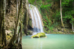 Waterfall in the jungle. Green lake royalty free stock photo