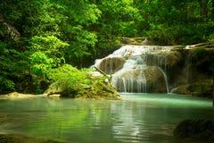 Waterfall in the jungle. Green lake stock photo