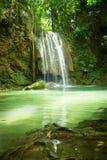 Waterfall in the jungle. Green lake stock image