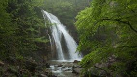 Waterfall Jur-Jur among green forest stock footage