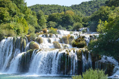 Waterfall of Krka River, Croatian National Park. Waterfall cascade surrounded by green trees Royalty Free Stock Image