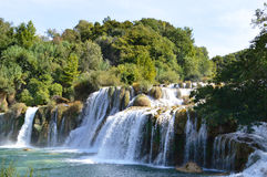 Waterfall of Krka River, Croatian National Park. Waterfall cascade surrounded by green trees Royalty Free Stock Photo