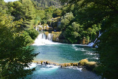 Waterfall of Krka River, Croatian National Park. Waterfall cascade surrounded by green trees Royalty Free Stock Images