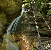 Waterfall with ladder in canyon Royalty Free Stock Images