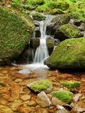 Waterfall with a lagoon on mountain stream Stock Photo