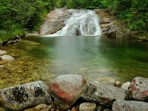 Waterfall with a lagoon on mountain stream Stock Image