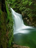 Waterfall with a lagoon on mountain stream Stock Photography
