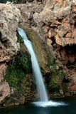 Waterfall lake. Closeup view of a small waterfall taken with a slow shutterspeed Stock Photography