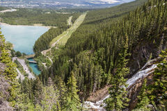 Waterfall and the lake in Canmore stock photography
