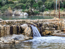 Waterfall from lake in datca Royalty Free Stock Images