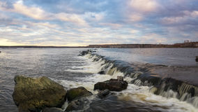 Waterfall on the lake in the evening, Russia, the Urals, Reftinskaya reservoir, Royalty Free Stock Photos