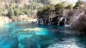 Waterfall  with lake. Located in  Jiuzhaigou stock video footage